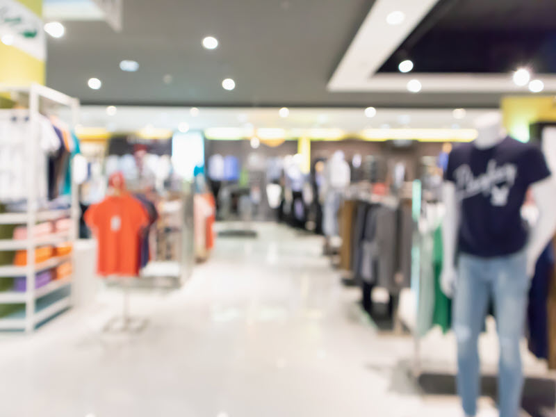Abstract blur clothing display interior of shopping mall background