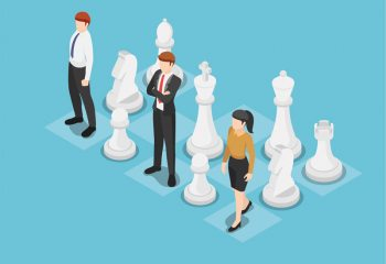 Business team standing on chess board with chess pieces