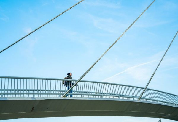 Person walking across a bridge