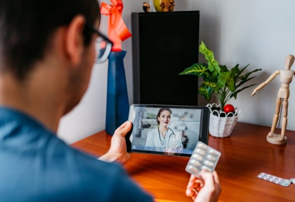 Practicing physician having online meeting with a patient